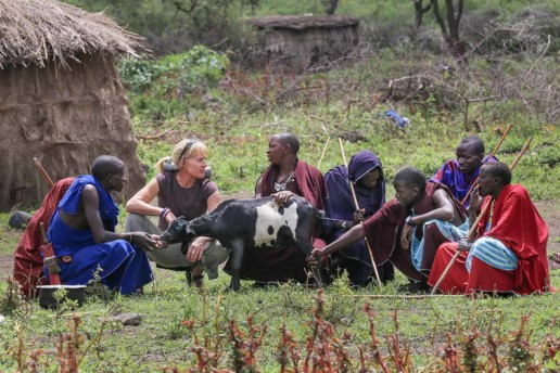 Ingela and lion scout Moloimet with other herders in Esere, discussing the latest event when striped hyena ripped into livestock enclosure (boma) and attacked goats.